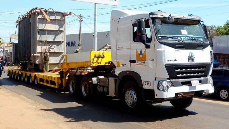 Tracto Camión con plancha Transportadora